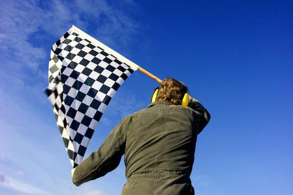 man waiving race flag